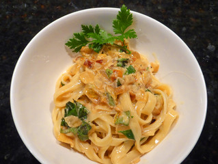 Fettucine with Caramelized Onions in White Wine, Cream, and Fresh Herbs.