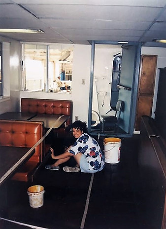 Amy cleaning the dining area