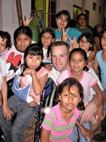 Jim and the girls from the Children's Village