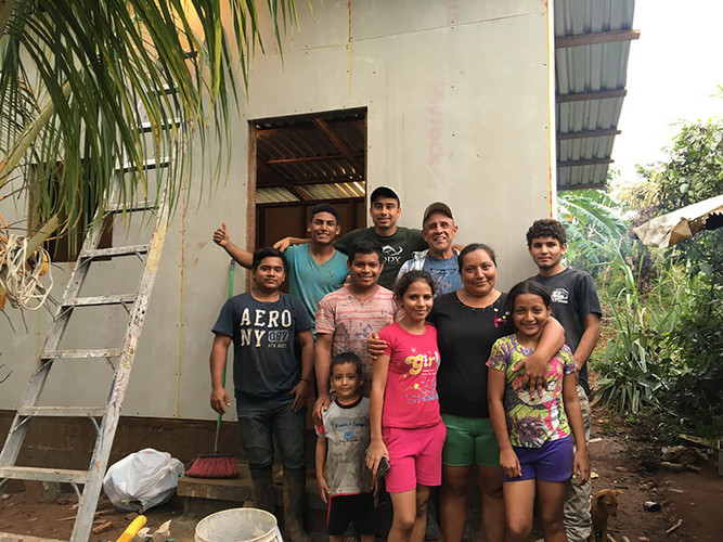 The family with their new house and the construction crew!
