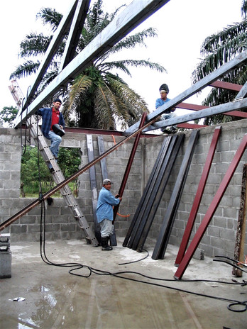 Building and cleaning the new girl's house at the Children's Village