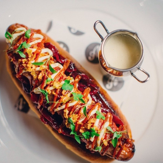 "Christmas ""pigs in blanket hot dog"", cranberry ketchup, wholegrain mustard mayo, caramalised red onion, camembert cheese sauce"