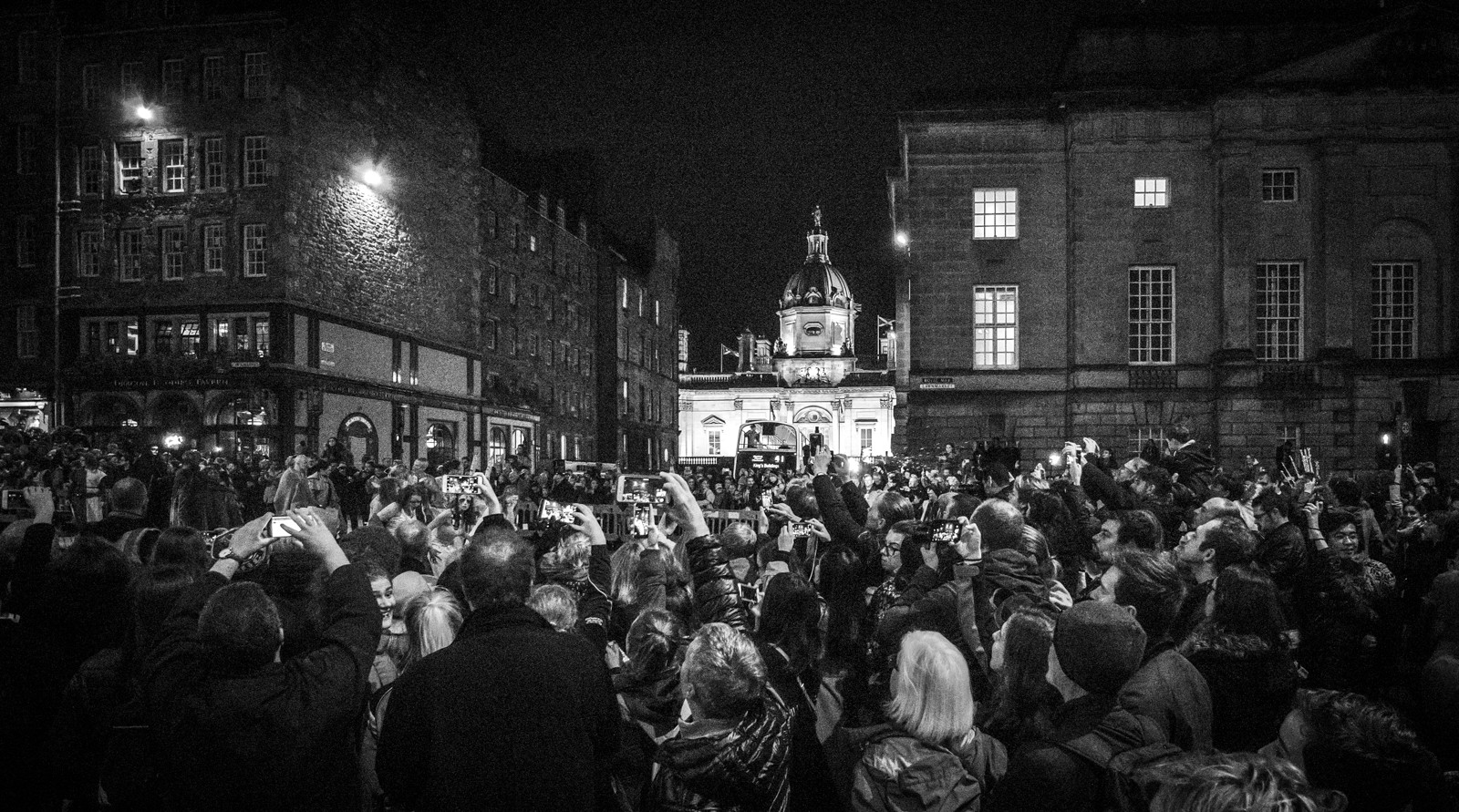 MONO - Crowd of Photojournalists by Nigel Bell (8 marks)