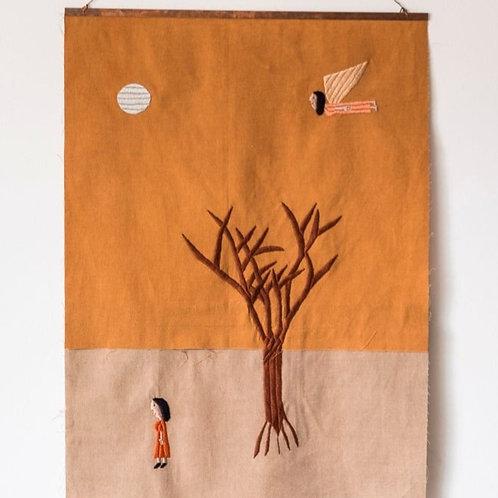 Mulher, árvore e anja
