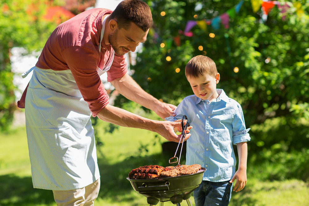 father and son grilling lawn care advice