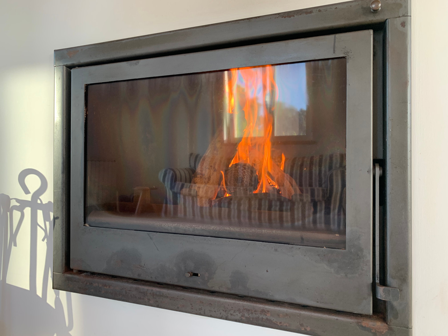 There are two fireplaces at Casa da Vida II -- the downstairs fireplace automatically heats all radiators throughout the house.