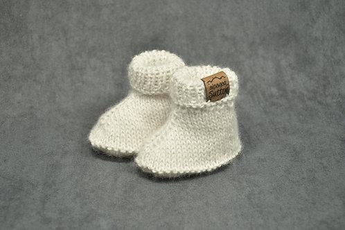White hand knitted alpaca newborn booties