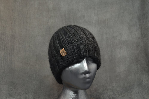Black colored fisherman style winter hat hand knitted with alpaca yarn