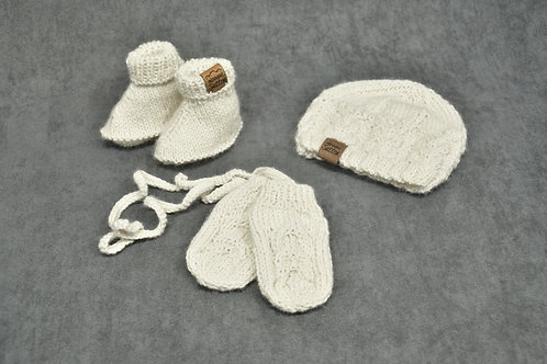 White hand knitted alpaca hat mittens and booties ensemble for newborn baby
