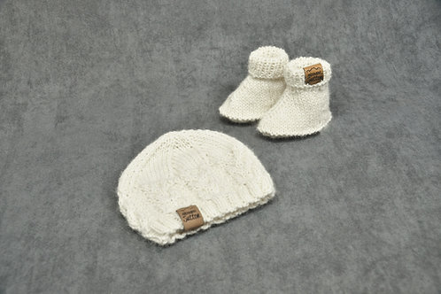 White hand knitted alpaca hat and booties for newborn baby