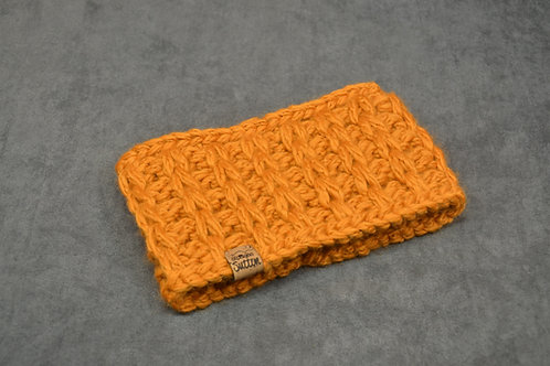 Orange colored headband hand knitted with chunky alpaca yarn
