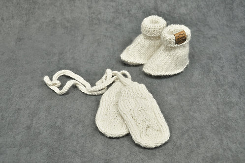 White hand knitted alpaca mittens and booties for newborn baby