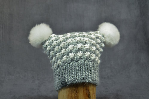 Grey and white hand knitted alpaca winter hat for toddlers with two pompoms