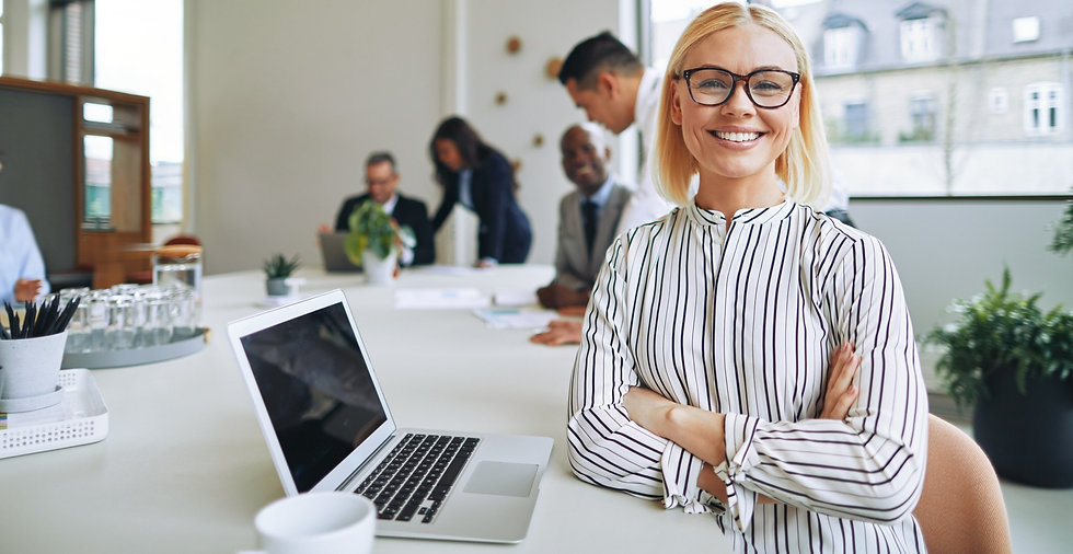 smiling-businesswoman-working-at-boardro