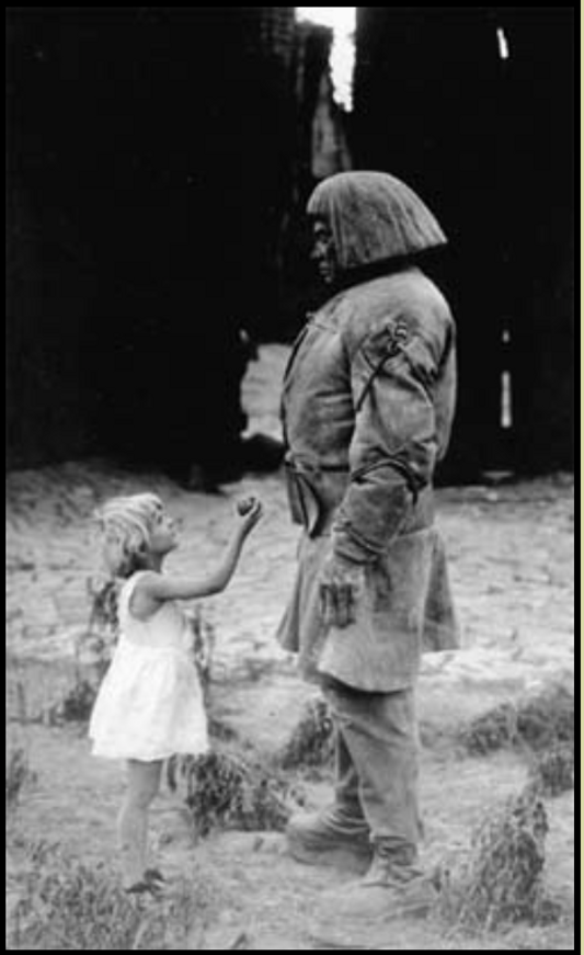 GOLEM AND LITTLE GIRL IMAGE.png