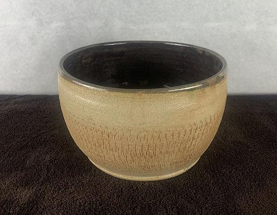 Medium mixing bowl with texture.
