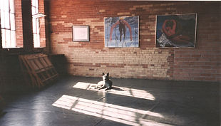 samson at 2480 with Ian's paintings.jpg