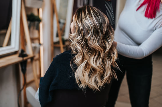 Beautiful hairstyle of young woman after