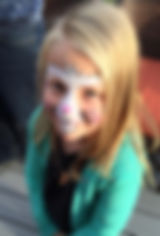 girl shows off bunny face paint