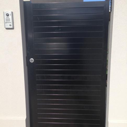 Slat gate by Adelaide Fencing Solutions.jpg