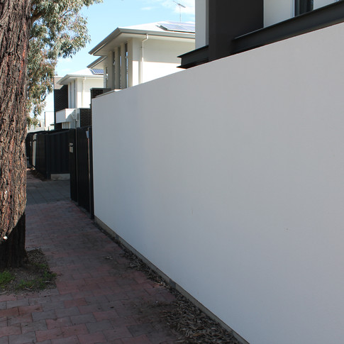 Rendered wall & tube Fencing by Adelaide Fencing Solutions.JPG