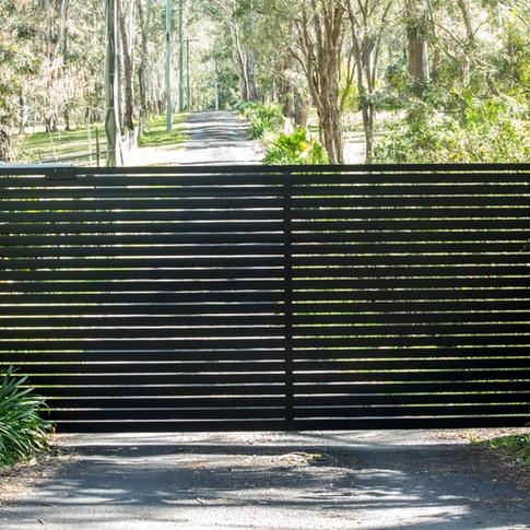 Black-metal-entrance-gates-leading-to-rural-driveway-845487004_4869x3246.jpeg