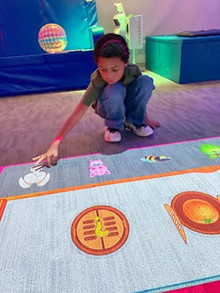boy using interactive elements in our se