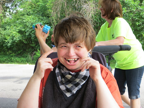 girl smiling sitting in a wheelchair