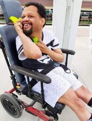 man in wheelchair smiling.jpg
