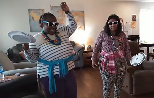 two women dancing in their home