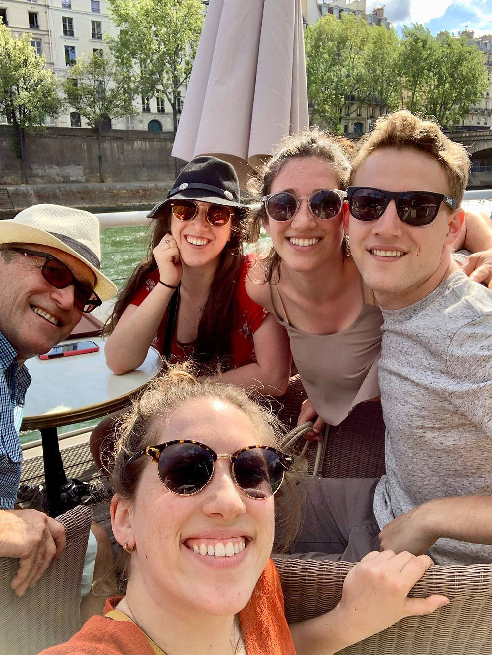 George with my family in Paris drinking on the Seine in 2019.