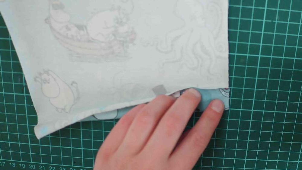 Baby onesie sleeve folds