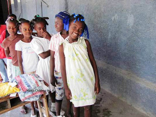 200 Children Receive Dresses and Washcloths from Haiti's Children Donors