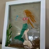 mermaid sitting on coral.jpg