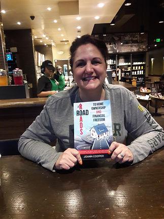 joanne seeing first copy of book.jpg