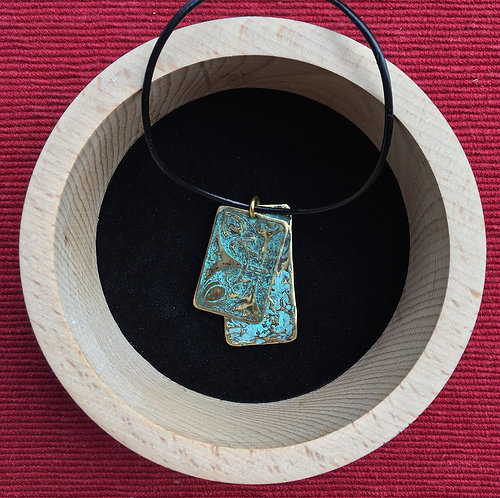 Pendant with leather cord