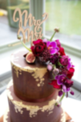 chocolate ganaché wedding cake with edible gold leaf