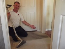 Graham half way through the cleaning of a hallway carpet.