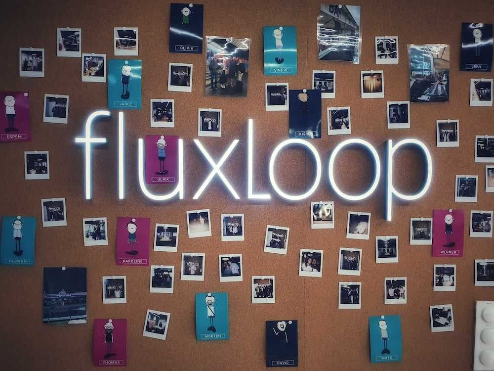 a corkboard with polaroid pictures on and the letters saying fluxloop