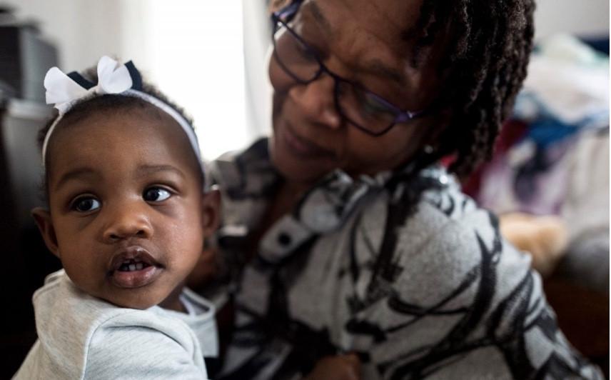 Black baby sitting on Grandma's lap