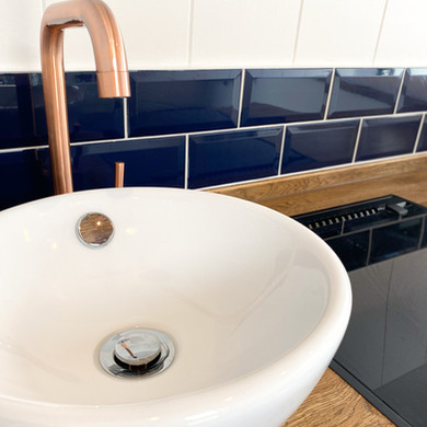 White sink and copper tap