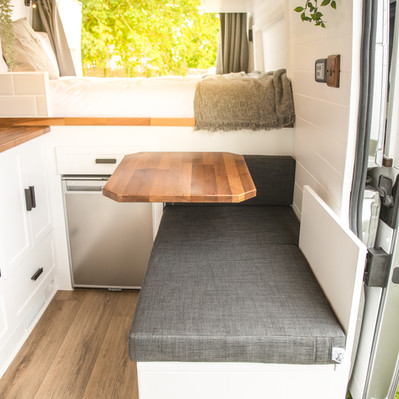 Seating area stows as a bench