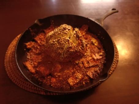 Whole roasted tandoor cauliflower with sesame flatbread