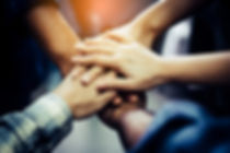 Businessman and Businesswoman,Concept of teamwork_ Close-Up of hands business team showing unity wit