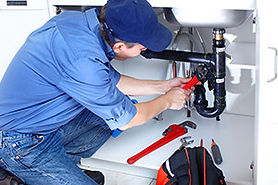 Plumber-working-on-his-trade-to-create-a