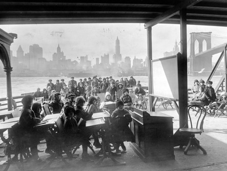 A classroom on a ferry in New York City, circa 1915. Bureau of Charities, via Library of Congress