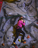 Girl climbing cave edited.png