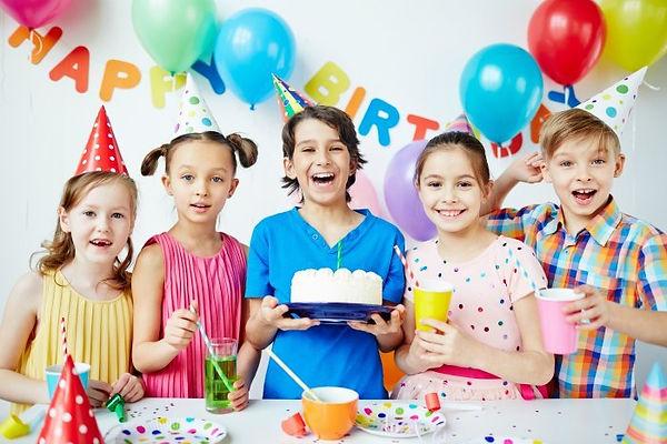 group-of-happy-children-celebrating-birt