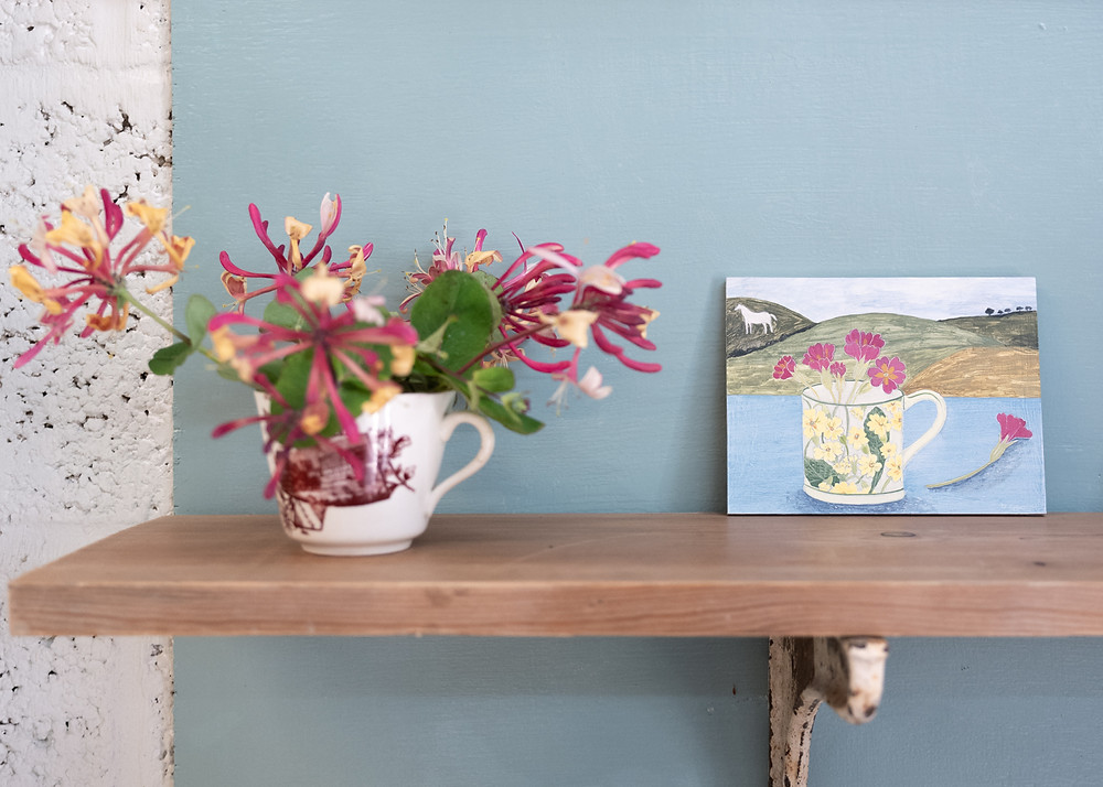 painting flowers with Debbie George, a cup full of honeysuckle and a painting by Debbie