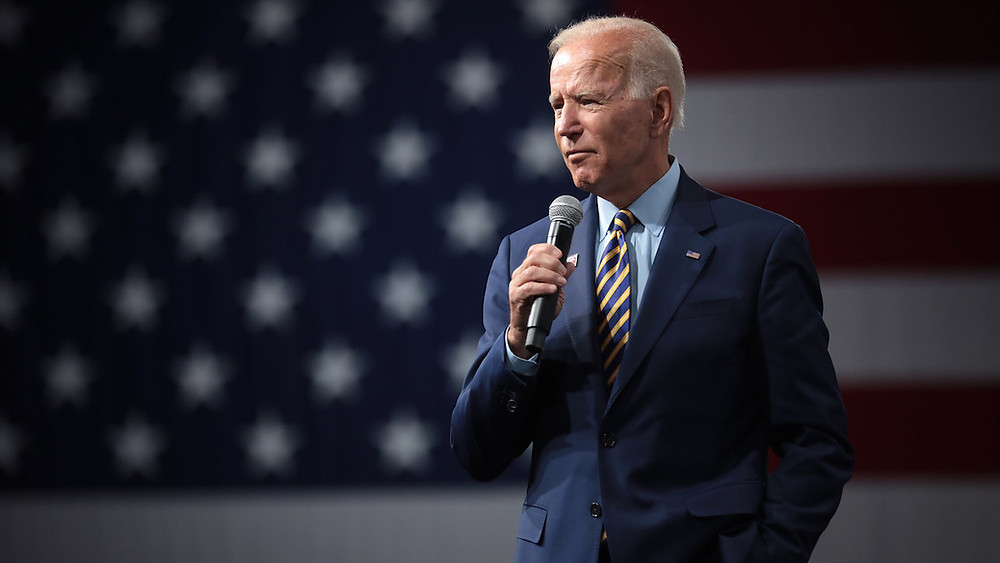 Joe Biden standing with a microphone in his hand.